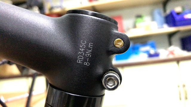 Torque setting calibration printed on bike stem